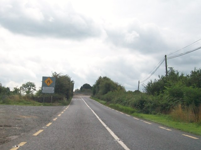 The northern approach to the narrow bridge over the Dublin-Galway railway line