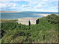 NU1635 : Gun Emplacement in dunes overlooking Budle Bay by Graham Robson