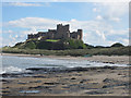NU1735 : Looking along the beach west of Bamburgh Castle by Graham Robson