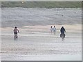 C3950 : Cyclists on the beach at Pollan Bay by Oliver Dixon