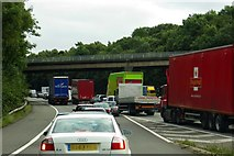 SJ8441 : Whitmore Road crosses a busy M6 by Steve Daniels