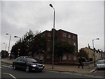 TQ2672 : Flats on the corner of Garratt Lane and Burmester Road by David Howard