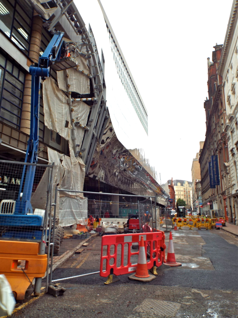 View along Stephenson Street with mirror-clad side of New Street station