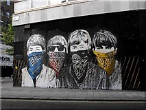 TQ3081 : Graffito - Museum Street WC1 - Bandit Beatles by Peter Thwaite