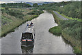 NS8579 : Approaching Narrowboat by Anne Burgess