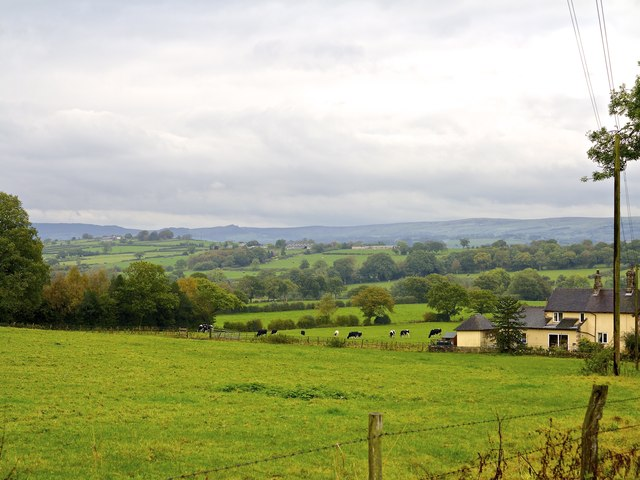 Looking over Brook House Farm from Toad Hall over Little Wood Cottages towards Leek and the Roaches in the far distance