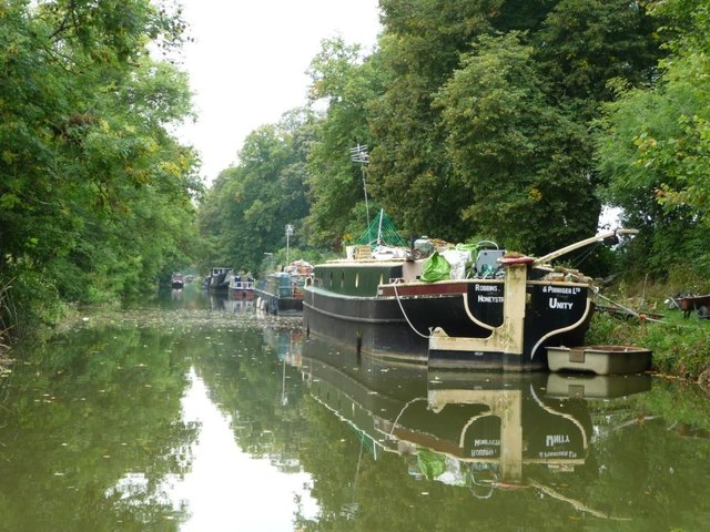 Moored residential boats alongside the towpath