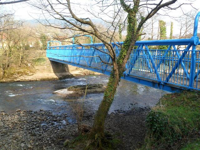 Side view of a blue footbridge over the Afon Afan in Cwmavon
