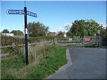 SD4364 : Schola Green Lane signpost by Christine Johnstone