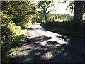 NY0881 : B7020 alongside Castle Loch by Steven Brown