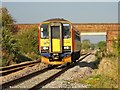 TF1605 : Peterborough to Lincoln railway line at Foxcovert Road crossing by Paul Bryan