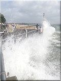 SZ1891 : Mudeford: waves breaking against the concrete quayside by Chris Downer