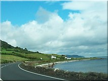 D3412 : The Antrim Coast Road at Drumnagreagh Bay by Eric Jones