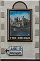 SH7877 : Pub sign and road sign by Ian Capper