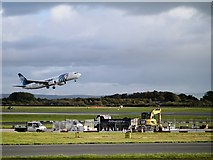 SJ8184 : Boeing 737 Taking Off at Manchester Airport by David Dixon