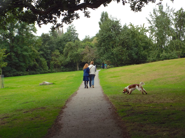 Mother and daughter dog-walk after school, Priory Park, Warwick