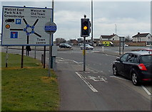 SU1584 : Cyclists dismount at the edge of the Magic Roundabout in Swindon by Jaggery