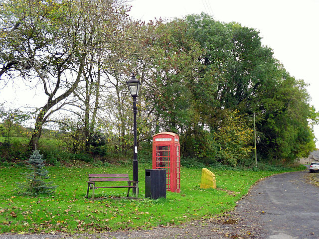 Bench and telephone box at Cumrew