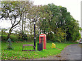 NY5450 : Bench and telephone box at Cumrew by Rose and Trev Clough