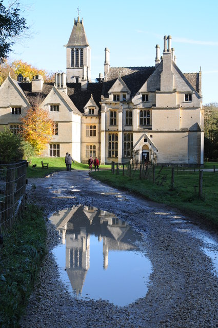 Woodchester Mansion reflected in a puddle