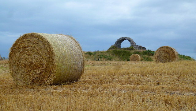 Straw bales and the 'eye' of Cruggleton Castle ruin