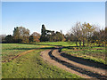 TL3764 : Lolworth: farm track and footpath near Grange Farm by John Sutton