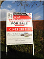TM2459 : Estate Agent Board at Hall Barn by Adrian Cable