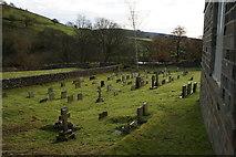 SE0361 : Graveyard at St Wilfrid Church, Burnsall, Yorkshire by Ian S