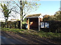 TM2693 : Bus Shelter Road & Name sign & Village Notice Board by Adrian Cable