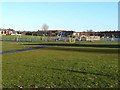 NZ2869 : Open space, play area and playing field, Longbenton by Oliver Dixon