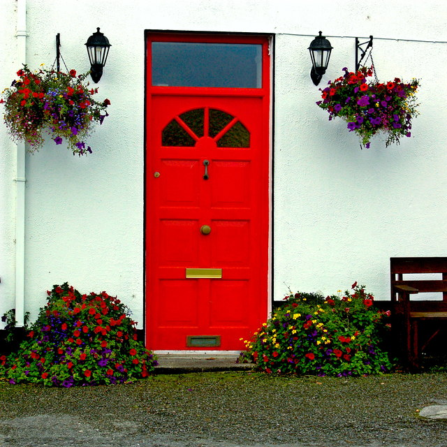 Ballyvaghan B&B - White Wall  & Red Door with Lanterns & Flowers at Both Sides