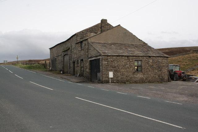 Farm buildings beside the A684 opposite Moorcock Inn