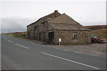 SD7992 : Farm buildings beside the A684 opposite Moorcock Inn by Roger Templeman