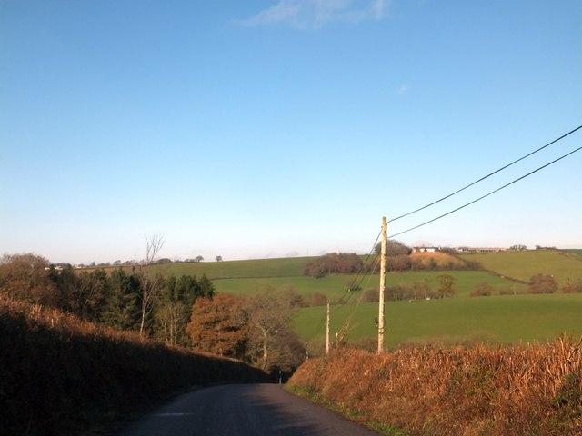 North of Cadbury Barton, a shallow valley with farmland