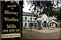 R4560 : Bunratty - Welcome Sign & Blarney Woollen Mills Building by Joseph Mischyshyn