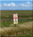 TF4952 : Warning sign at the former RAF Wainfleet by Mat Fascione