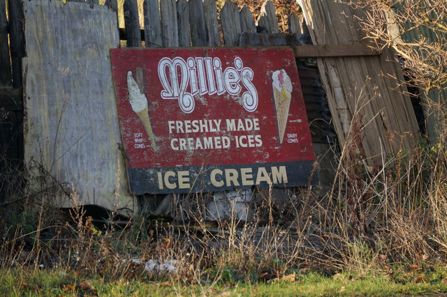 Old advertisement board for Millie's Ice Cream