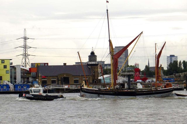 A Thames Barge is towed up the River Thames