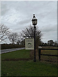 TL2657 : Home Barn Laycout Farm sign by Adrian Cable