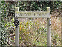 TL2656 : Bridge House sign by Adrian Cable