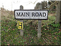 TL2655 : Main Road sign by Adrian Cable