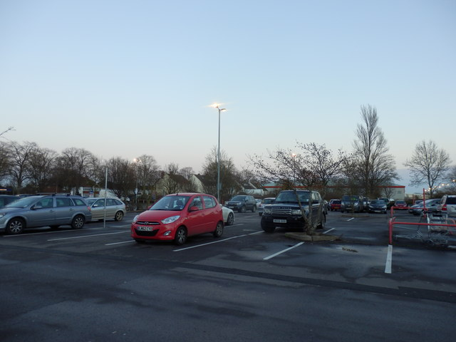 Car park of retail park at dusk