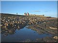 NU2521 : Winter sunshine, Dunstanburgh Castle by Karl and Ali