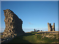 NU2521 : People on the walls of Dunstanburgh Castle by Karl and Ali