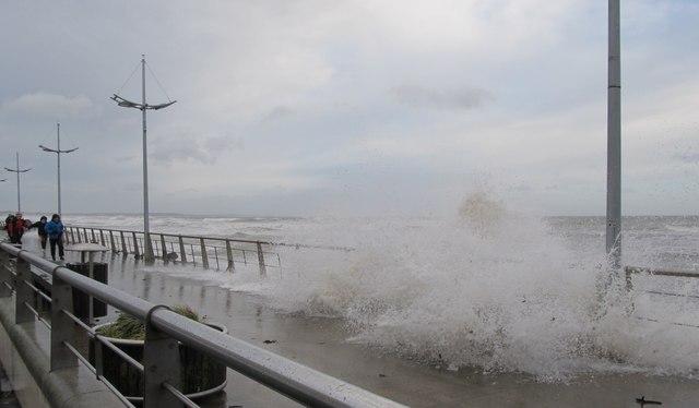 Crashing waves on the promenade at Newcastle