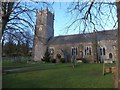 SY6488 : The churchyard and church of St Martin, Martinstown by David Smith