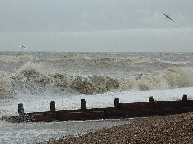 Surf and groyne on East Worthing beach, West Sussex