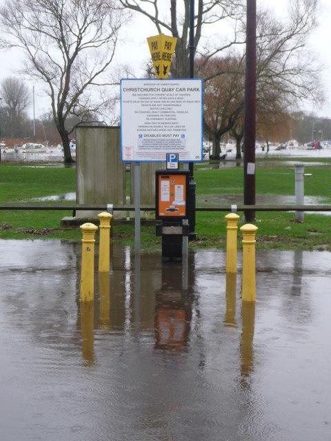 Christchurch: car park ticket machine stands in floodwater