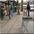 SJ9494 : Reflections at the bus stop by Gerald England