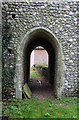 TG1937 : St Andrew, Metton - Passage under tower by John Salmon